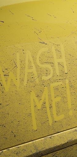 wash me written on car door